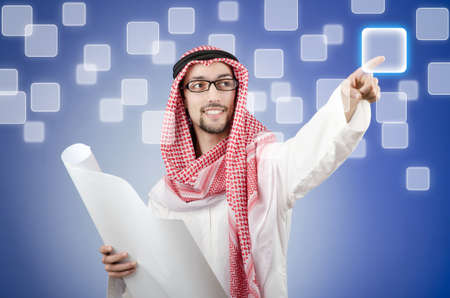 Young arab pressing virtual buttons Stock Photo - 13597018