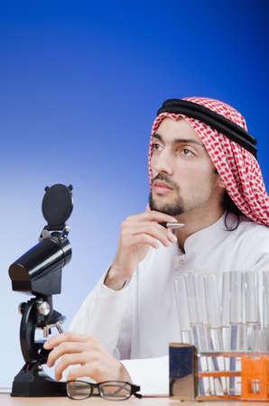 Arab chemist working in lab Stock Photo - 13597017