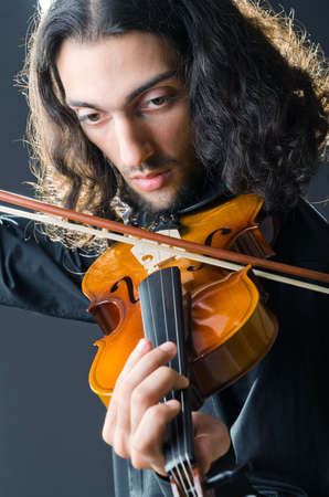 Fiddler playing the violin photo