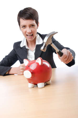 Woman and piggybank on white photo
