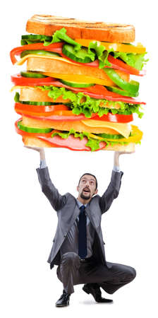 Man and giant sandwich on white photo