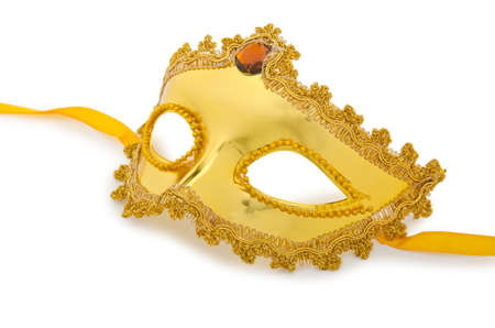 Golden mask isolated on the white photo
