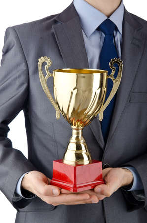Man being awarded with golden cup photo