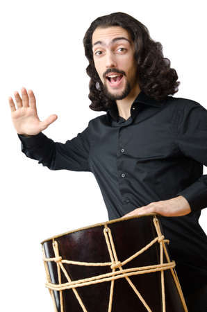 Drummer with drum playing on white photo