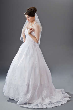 Bride in wedding dress in studio shooting photo