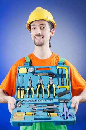 Repairman with his toolkit photo