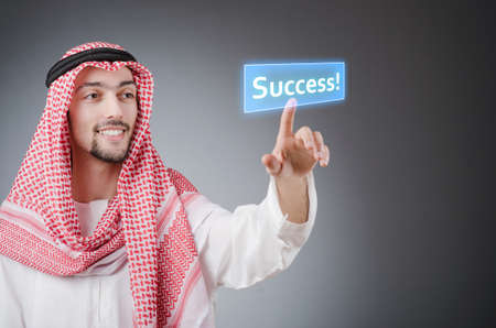 Young arab pressing virtual buttons Stock Photo - 13868008