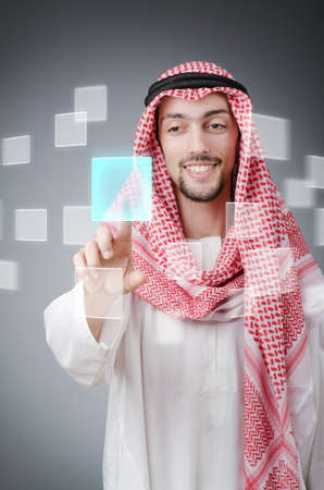 Young arab pressing virtual buttons Stock Photo - 13867934