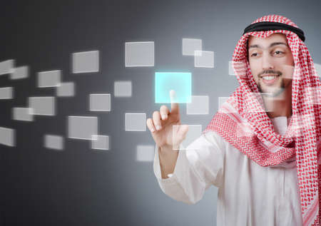 Young arab pressing virtual buttons Stock Photo - 13867939