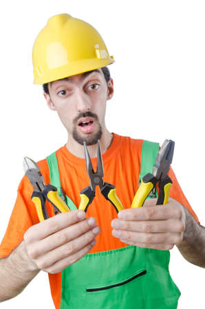 Repairman in coveralls in industrial concept photo
