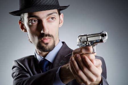 Businessman man with hand gun photo