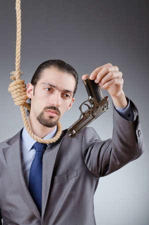 Businessman man with hand gun Stock Photo - 13868119
