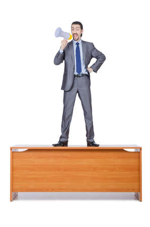 Businessman with loudspeaker at the desk photo