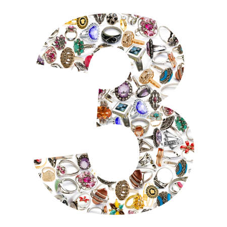 Number made of jewellery rings on white photo