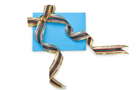 Envelope with colourful ribbon on white Stock Photo - 14043323
