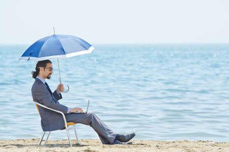 Man with umbrella on seaside beach Stock Photo - 14385694