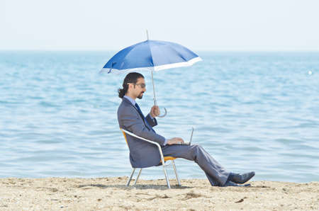 Man with umbrella on seaside beach Stock Photo - 14385732