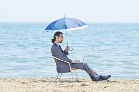 Man with umbrella on seaside beach Stock Photo - 14385732