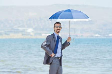 Man with umbrella on seaside beach Stock Photo - 14385684