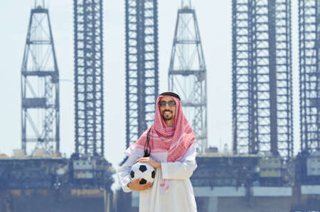 world cup: Arab with footbal at seaside