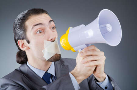 Businessman shouting via loudspeaker Stock Photo - 14385876