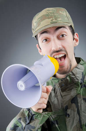 Soldier with loudspeaker shouting photo