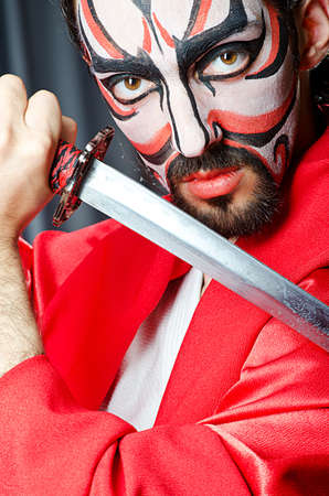 Man with face mask and sword Stock Photo - 14096293