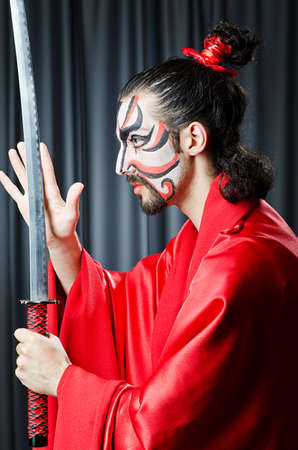 Man with face mask and sword Stock Photo - 14096290