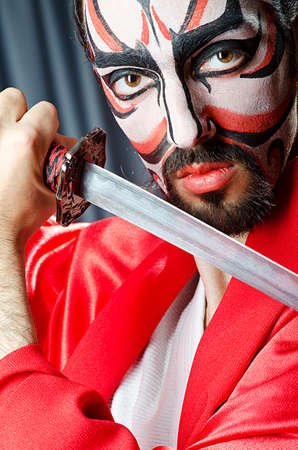 Man with face mask and sword Stock Photo - 14096294