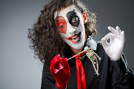 Joker with face mask in studio Stock Photo - 14385898