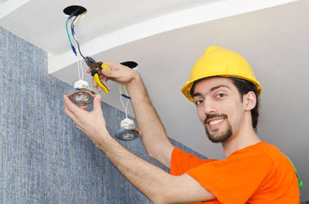 Electrician repairman working on refurbishment photo