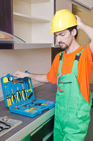 Repairman assembling the furniture at kitchen Stock Photo - 14385853