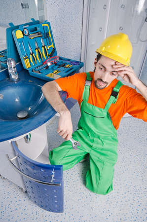 Plumber working in the bathroom Stock Photo - 14385843