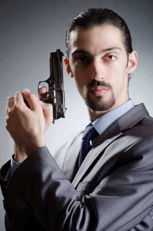 Businessman man with hand gun photo