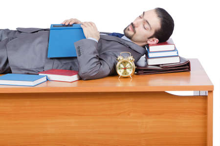 Businessman sleeping at this desk photo