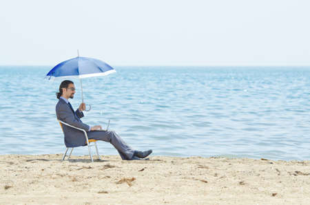 Man with umbrella on seaside beach Stock Photo - 14385758