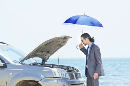 Man with car on seaside Stock Photo - 14385675
