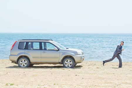 Man with car on seaside Stock Photo - 14385801
