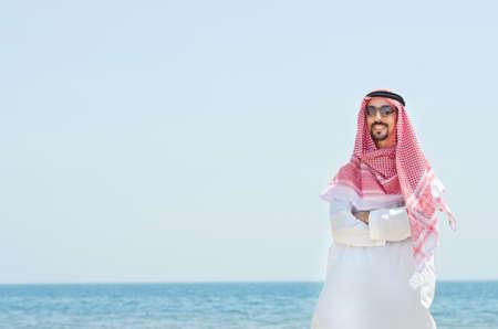 qameez: Arab on seaside in traditional clothing