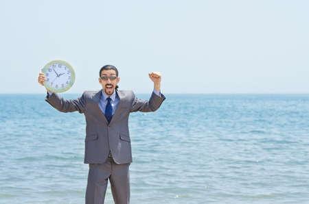 Man with clock on seaside photo