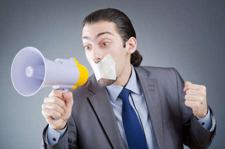 Businessman shouting via loudspeaker Stock Photo - 14385879