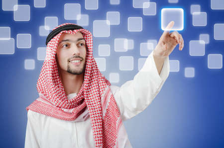Young arab pressing virtual buttons Stock Photo - 14385817