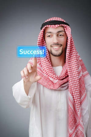 Young arab pressing virtual buttons Stock Photo - 14385788