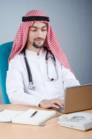 Arab doctor working in hospital photo