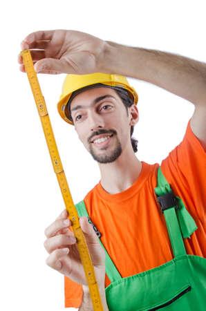 Repairman in coveralls in industrial concept photo