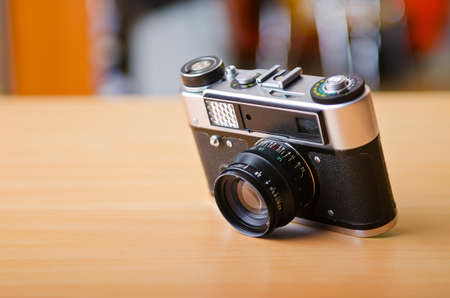 Vintage camera on the table photo