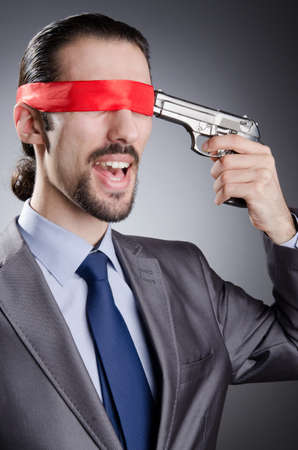 Businessman man with hand gun Stock Photo - 14385907