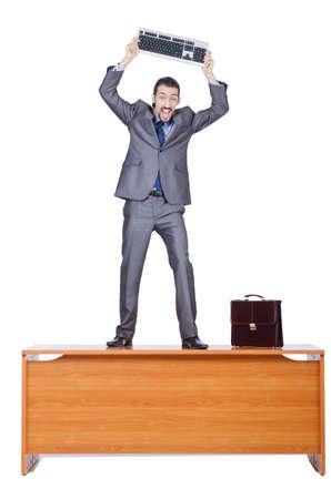 destroying: Businessman breaking his computer