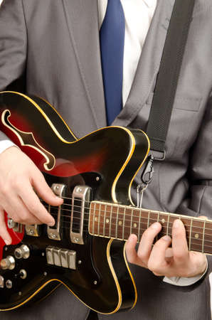 guitar player: Guitar player in business suit on white