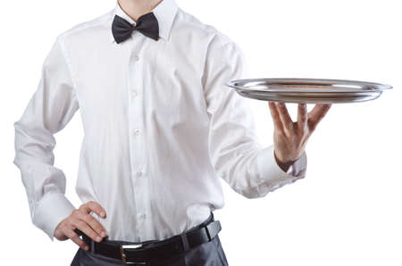 Young waiter with silver tray photo